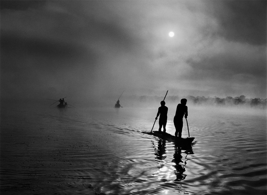 C/O Berlin | Sebastiao Salgado - Genesis, Amazônia & Pantanal, A Group Of Waura Indians Fish In The Puilanga Lake Near Their Village. Upper Xingu. Mato Grosso State. Brazil. 2005