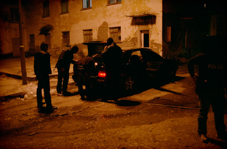 After 14 Hours, Two Suspects Vehicles Are Seized And Taken To A Warehouse For Further Inspection. The Next Day The Entire Warehouse, Including Cars Is Burned To The Ground In A Mysterious Fire. Tirana, 2008, Albania © Robert Knoth & Antoinette De Jong