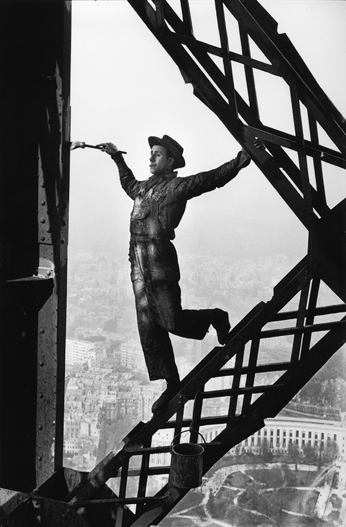 Painter On The Eiffel Tower, Paris, 1953 © Marc Riboud