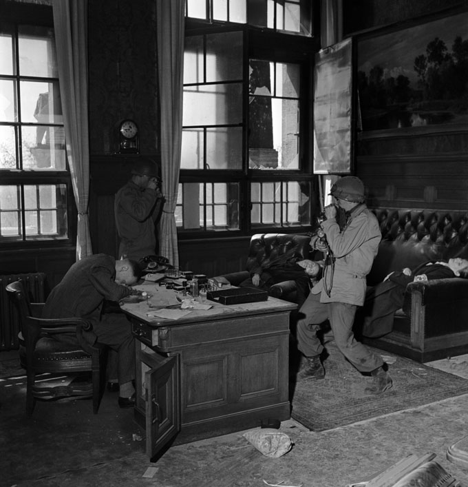 Lee Miller, David E. Sherman Photographing The Burgermeister's Suicide, Town Hall, Leipzig, Germany, 1945 © Lee Miller Archives, England 2016. All Rights Reserved. Www.leemiller.co.uk
